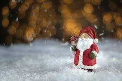 Santa Claus ceramic figure. Christmas decoration on blured background Stock Images
