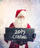 Santa Claus with chalkboard stock photo