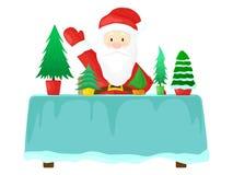 Santa Claus che dà un albero di Natale Gli alberi di Natale sono sulla tavola Fotografia Stock