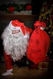 Santa Claus che esce dalla stufa Fotografie Stock