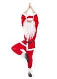Santa Claus che fa esercizio di yoga Fotografie Stock