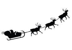 Santa Claus che guida in una slitta Fotografia Stock Libera da Diritti