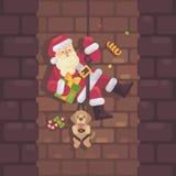 Santa Claus che rappelling giù il camino con un cane e un presente Fotografia Stock