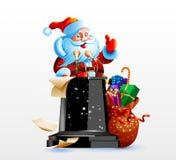 Santa Claus che sta dietro un podio Immagini Stock