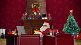Santa Claus checking blood pressure and talking on mobile to his doctor, office with Christmas decorations, stock footage Royalty Free Stock Images