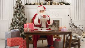 Santa Claus checking his list of presents stock photo