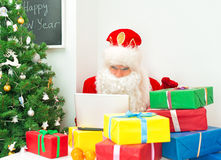 Santa Claus checking wish list. stock photo