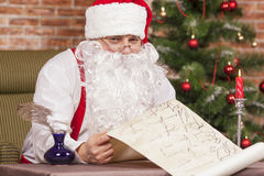 Santa Claus checks his list Stock Photo