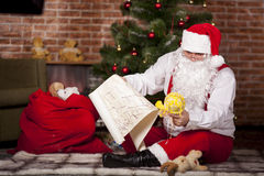 Santa Claus checks his list Stock Photography