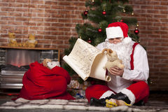 Santa Claus checks his list Royalty Free Stock Photos
