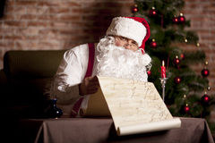 Santa Claus checks his list Royalty Free Stock Images