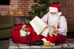 Santa Claus checks his list Stock Photos