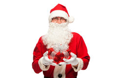 Santa Claus: Cheerful With Small Stack Of Gifts Stock Photo