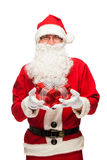 Santa Claus: Cheerful With Small Stack Of Gifts Stock Images
