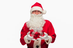 Santa Claus: Cheerful With Small Stack Of Gifts Royalty Free Stock Photography