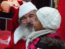 Santa claus with child at bucharest christmas fair Stock Image