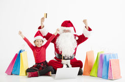 santa claus  and child Christmas Online Shopping Royalty Free Stock Photo