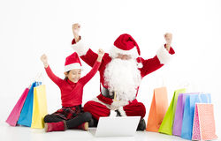 santa claus  and child Christmas Online Shopping Royalty Free Stock Photography