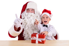Santa Claus and child Stock Images