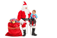 Santa Claus and child with a gift posing Stock Image