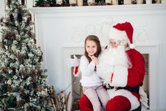 Santa Claus and child at home. Christmas gift. Family holiday concept Stock Photo