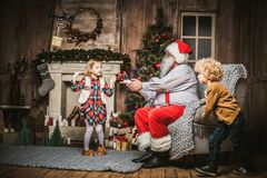 Santa Claus with children using hexacopter drone royalty free stock images