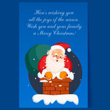 Santa Claus in Chimney on Christmas Eve. Winter Stock Photo