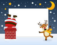Santa Claus in the Chimney Frame. Christmas horizontal photo frame with Santa Claus stuck in a chimney and a naughty reindeer laughing on the snow. Eps file Stock Photography