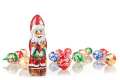 Santa Claus chocolate figure with xmas decoration Royalty Free Stock Images