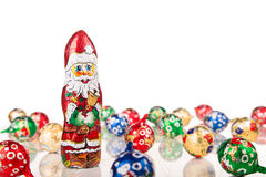 Santa Claus chocolate figure with xmas decoration Royalty Free Stock Photography