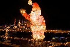 Santa Claus in Christmas. Wired Santa Claus waving his arm at night during the Holidays Royalty Free Stock Photo