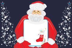 Santa Claus with Christmas banner in hands Royalty Free Stock Photography
