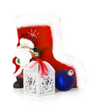 Santa Claus and Christmas boots isolated on white Royalty Free Stock Images