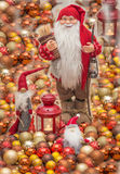 Santa Claus. Christmas card.Old Santa surrounded with little santa`s and christmas globes Royalty Free Stock Photography