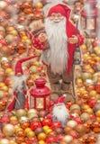 Santa Claus. Santa Claus Christmas card.Old Santa surrounded with small Santa`s and christmas globe Stock Images