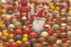 Santa Claus. Christmas card.Old Santa surrounded with small Santa`s and christmas globe Royalty Free Stock Photo