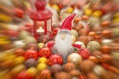 Santa Claus. Christmas card.Old Santa surrounded with small Santa`s and christmas globe motion blur Stock Photo