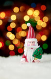 Santa Claus christmas decoration. Santa Claus figurine against beautiful bokeh Royalty Free Stock Photos