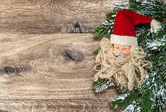 Santa Claus christmas decoration with pine tree branch Stock Photos