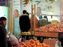 Santa Claus Christmas decorations on Chinese fruit shop Stock Photo