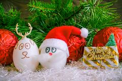 Santa Claus and Christmas deer on Christmas .Unusual eggs with t. He faces ,muzzle. The cartoon Christmas decorations Stock Images