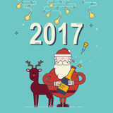 Santa Claus with christmas deer. 2017 new year greeting card. Royalty Free Stock Photography