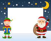 Santa Claus and Christmas Elf Frame. Christmas horizontal photo frame with Santa Claus smiling and greeting and an elf holding a gift on the snow. Eps file Royalty Free Stock Images