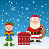 Santa Claus and Christmas Elf on a Roof Royalty Free Stock Images