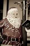 Santa Claus christmas figure leaning against a lig Stock Photo