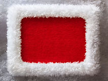 Santa Claus Christmas frame with empty space. White fur New Year frame with red velvet empty space (looks like a Santa outfit Royalty Free Stock Photos