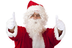 Santa Claus with Christmas fur cap shows thumbs Royalty Free Stock Photo