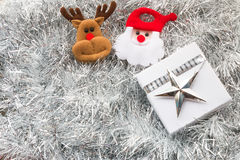 Santa claus, Christmas gift box and decoration. On silver fir twigs background Stock Photo