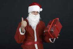 Santa Claus with Christmas Gift Box. Isolated on Black Background Royalty Free Stock Photos