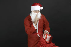 Santa Claus with Christmas Gift Box. Isolated on Black Background Royalty Free Stock Image